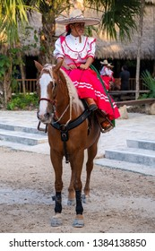 XCARET,MEXICO - APRIL 16,2019 : Young amazon riding a purebred horse at the XCaret park on the Mayan Riviera