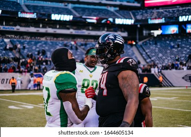XFL- 2/9/20-MetLife Stadium East Rutherford,NJ- The Guardians host the Vipers on opening day of the XFL. Vipers and Guardians showing sportsmanship.