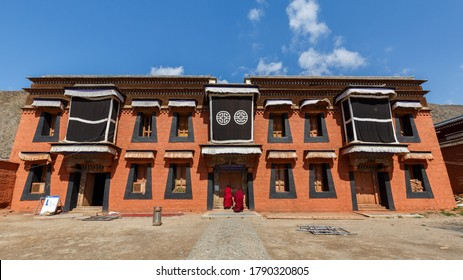 Xiahe, Gansu Province / China - April 28, 2017: Front view of building at Labrang Monastery. House with typical tibetan elements (windows, color, shape etc.).