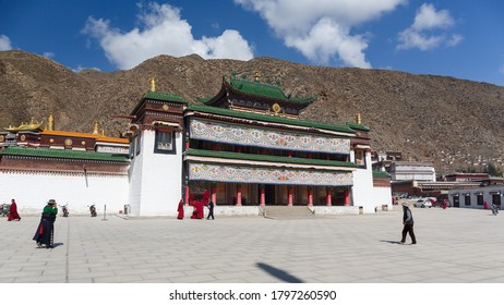 Xiahe, Gansu Province / China - April 28, 2017: Temple building at Labrang Monastery. Traditional tibetan architecture. Green colored roof, white walls, windows with black frame.