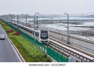 Xiamen, China - Apr 07, 2018: Running Subway At Seaside Near Xiamen Garden Expo