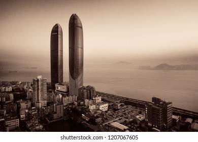 """XIAMEN, CHINA – FEB 16: Aerial view of Shimao Twin Tower and city skyline on February 26, 2018 in Xiamen. Xiamen was ranked as China's 2nd-""""most suitable city for living"""""""
