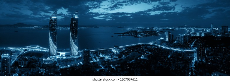 """XIAMEN, CHINA – FEB 16: Aerial view of city at night on February 26, 2018 in Xiamen. Xiamen was ranked as China's 2nd-""""most suitable city for living"""""""