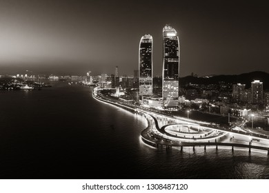 "XIAMEN, CHINA – FEB 16: Aerial view of city at night on February 26, 2018 in Xiamen. Xiamen was ranked as China's 2nd-""most suitable city for living"""