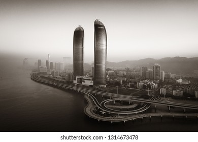 "XIAMEN, CHINA – FEB 16: Aerial view of Shimao Twin Tower and city skyline on February 26, 2018 in Xiamen. Xiamen was ranked as China's 2nd-""most suitable city for living"""