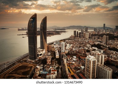 "XIAMEN, CHINA – FEB 16: Aerial view of Shimao Twin Tower at sunset on February 26, 2018 in Xiamen. Xiamen was ranked as China's 2nd-""most suitable city for living"""