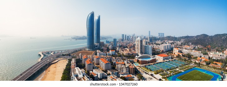 """XIAMEN, CHINA – FEB 16: Aerial panorama view of Shimao Twin Tower and city skyline on February 26, 2018 in Xiamen. Xiamen was ranked as China's 2nd-""""most suitable city for living"""""""