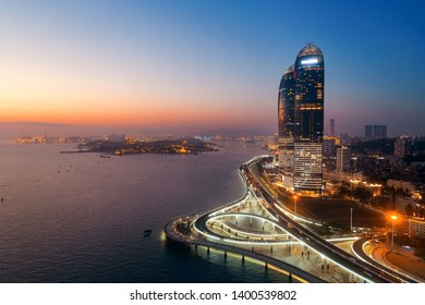 """XIAMEN, CHINA – FEB 16: Aerial view of Shimao Twin Tower at sunset on February 26, 2018 in Xiamen. Xiamen was ranked as China's 2nd-""""most suitable city for living"""""""
