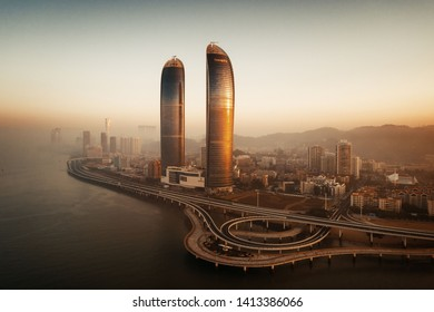 "XIAMEN, CHINA – FEB 16: Aerial view of city skyline at sunrise on February 26, 2018 in Xiamen. Xiamen was ranked as China's 2nd-""most suitable city for living"""