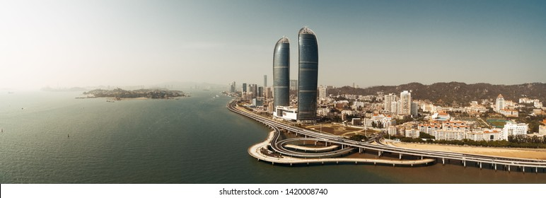 """XIAMEN, CHINA – FEB 16: Aerial panorama view of city skyline on February 26, 2018 in Xiamen. Xiamen was ranked as China's 2nd-""""most suitable city for living"""""""