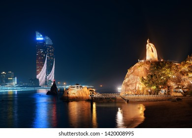 """XIAMEN, CHINA – FEB 16: City skyline at night viewed from Gulangyu on February 26, 2018 in Xiamen. Xiamen was ranked as China's 2nd-""""most suitable city for living"""""""