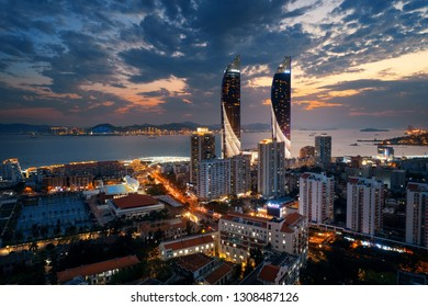 "XIAMEN, CHINA – FEB 16: Dusk aerial view of city skyline on February 26, 2018 in Xiamen. Xiamen was ranked as China's 2nd-""most suitable city for living"""