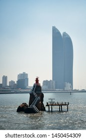 """XIAMEN, CHINA – FEB 16: Lighthouse and Shimao Tween Tower on February 26, 2018 in Xiamen. Xiamen was ranked as China's 2nd-""""most suitable city for living"""""""