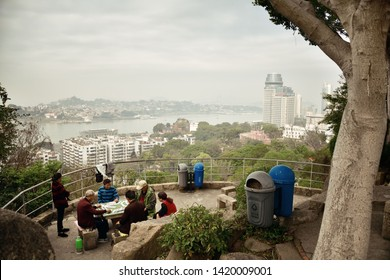 """XIAMEN, CHINA – FEB 16: People play games at mountain top on February 26, 2018 in Xiamen. Xiamen was ranked as China's 2nd-""""most suitable city for living"""""""