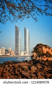 """XIAMEN, CHINA – FEB 16: Shimao Twin Tower and beach on February 26, 2018 in Xiamen. Xiamen was ranked as China's 2nd-""""most suitable city for living"""""""