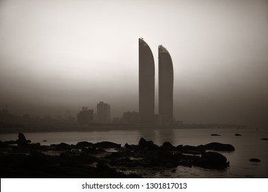 "XIAMEN, CHINA – FEB 16: Shimao Twin Tower silhouette at sunrise on February 26, 2018 in Xiamen. Xiamen was ranked as China's 2nd-""most suitable city for living"""