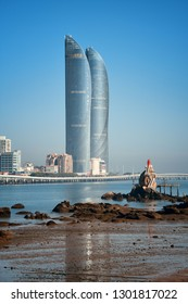 "XIAMEN, CHINA – FEB 16: Shimao Twin Tower and beach on February 26, 2018 in Xiamen. Xiamen was ranked as China's 2nd-""most suitable city for living"""