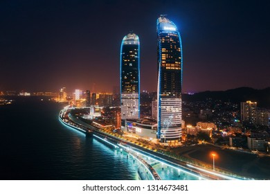 "XIAMEN, CHINA – FEB 16: Shimao Twin Tower and city skyline night aerial on February 26, 2018 in Xiamen. Xiamen was ranked as China's 2nd-""most suitable city for living"""