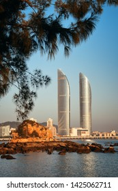 """XIAMEN, CHINA – FEB 16: Shimao Twin Tower and trees on February 26, 2018 in Xiamen. Xiamen was ranked as China's 2nd-""""most suitable city for living"""""""
