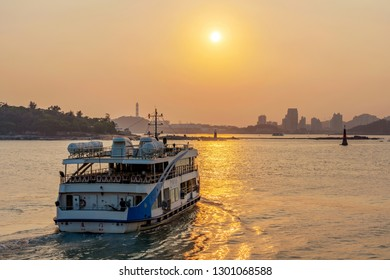 XIAMEN, CHINA -OCTOBER 08: This is a ferry departing from Xiamen to Gulangyu Island during sunset on October 08, 2018 in Xiamen