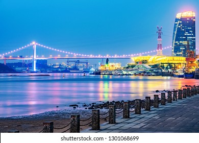 XIAMEN, CHINA -OCTOBER 08: This is a view of the famous Haicang Bridge from Xiamen Bay Park at night on October 08, 2018 in Xiamen