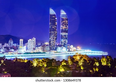 XIAMEN, CHINA -OCTOBER 10: Night view of the Shimao Straits Towers, two famous landmark towers on the Xiamen seafront on October 10, 2018 in Xiamen