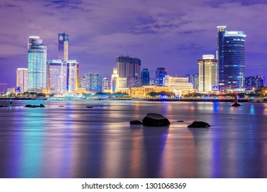 XIAMEN, CHINA -OCTOBER 11: Night view of Xiamen skyline and waterfront architecture from Gulangyu Island on October 11, 2018 in Xiamen
