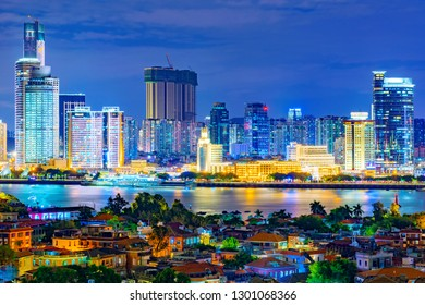 XIAMEN, CHINA -OCTOBER 11: This is a night view of Xiamen city skyline with Gulangyu island in the foreground on October 11, 2018 in Xiamen
