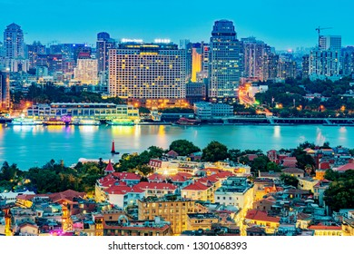 XIAMEN, CHINA -OCTOBER 11: This is a night view of Gulangyu Island in the foreground with Xiamen waterfront city buildings in the distance on October 11, 2018 in Xiamen