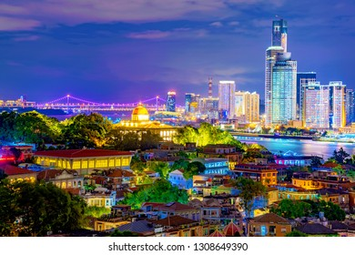 XIAMEN, CHINA -OCTOBER 11: This is a night view of Gulangyu Island old buildings with Xiamen modern city buildings in the distance on October 11, 2018 in Xiamen