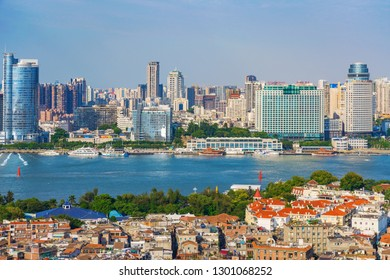 XIAMEN, CHINA -OCTOBER 12: This is a view Gulangyu island in the foreground with Xiamen city Skyline in the distance on October 12, 2018 in Xiamen