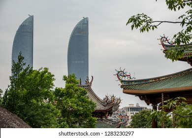 XIAMEN, CHINA - OCTOBER 31, 2018: Xiamen Shimao Straits Towers behind South Putuo or Nanputuo Temple