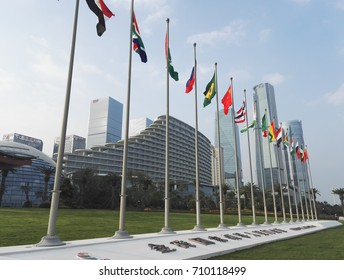 Xiamen, China - Sep 6, 2017: BRICS countries flags waving in the wind with xiamen international conference background