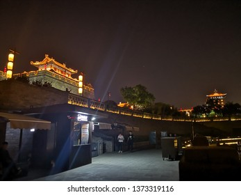 xian, China- April 17,2019: the bank of xian city moat in night, with the background of xian city wall and default castle