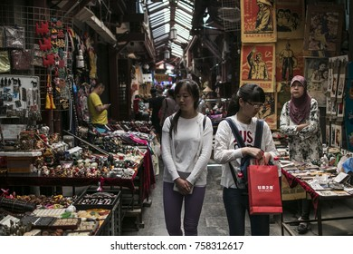 XI'AN, CHINA - APRIL 30, 2016. Local Chinese tourist visit art craft market in Xi'an, China. Low light and high ISO photography.