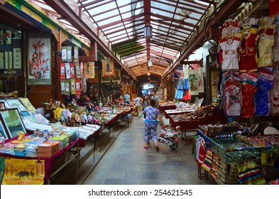 XIAN, CHINA, AUGUST 24, 2013: People are walking through shopping alley in chinese city xian.