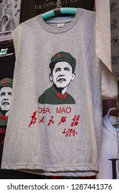 Xian / China - August 3rd 2015: T-shirt depicting 44th president of the United States Barack Obama dressed as Mao Zedong and wordplay Oba Mao, souvenir shop at street market in Xian, China