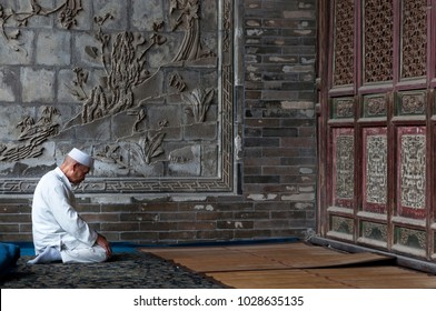 Xi'An, China - August 5, 2012: One man praying at the Xi'An Great Mosque in the city of Xi'An in China, Asia.