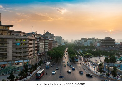 Xian, China - August 6, 2012: Street scene in the city of Xian at sunset, with an avenue and a cars, in China, Asia