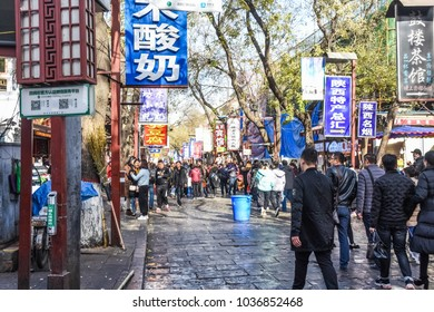 XI'AN, CHINA, DECEMBER 24 2017: People walking on the main street of the walled city, full of food