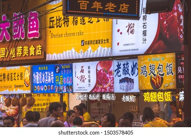 Xian, China -  July 2019 : Colorful and brightly illuminated and lit neons and shop boards in the popular street food district called Muslim Quarte