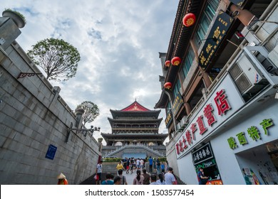Xian, China -  July 2019 : People climbing up the stairs leading to the landmark Drum Tower in the city Xian, Shaaxi Province