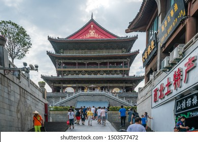 Xian, China -  July 2019 : People walking towards the landmark Drum Tower in the city Xian, Shaaxi Province