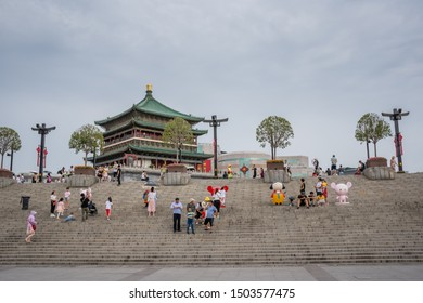 Xian, China -  July 2019 : People climbing up the stairs leading to the landmark Drum Tower in the city Xian, Shaaxi Province, Central China