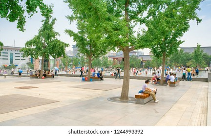 Xian, China - July 25, 2010: Local people and tourists walkin and playing with water on summer day in the Music Fountain, which is said to be the largest music fountain in Asia.