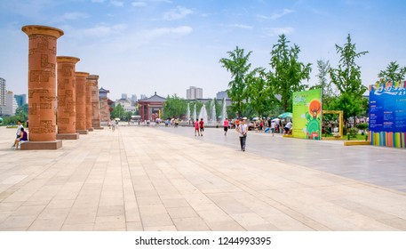 Xian, China - July 25, 2010: Local people and tourists walkin in Dayan Pagoda Square. Dayan Pagoda Square has many featured sculptures and gardens around the pagoda and temple.