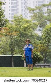 XI'AN, CHINA - JULY 31, 2017 : Gardener in a park at Xian city wall at early morning.
