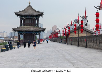 XIAN, CHINA - MAY 23, 2018:  Tourists walk on the South Gate of Xian City Wall ,one of the oldest and best preserved Chinese city walls April 16, 2010 in Xian of Shaanxi Province, China.