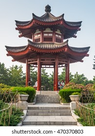 Xian, China - October 17, 2013: People sitting under a pagoda on the territory of the Giant Wild Goose Pagoda located in Xian China,
