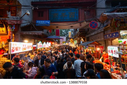 Xi'an, China  - October 7,2017: People and street vendor in the Muslim Quarter in Xi'an